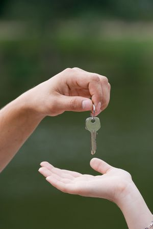 appartment: Man handing a woman keys