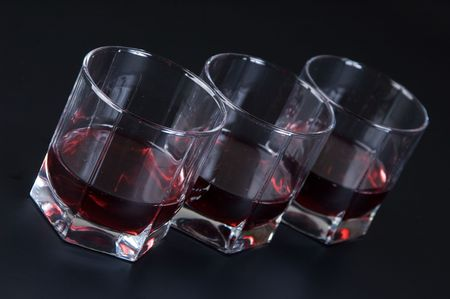 bar ware: Glasses with a drink against a dark background