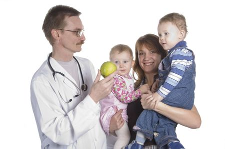 useful: The woman with the child on reception at the childrens doctor Stock Photo