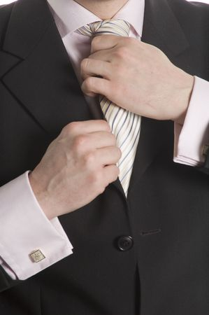 The man in a business suit corrects a tie photo