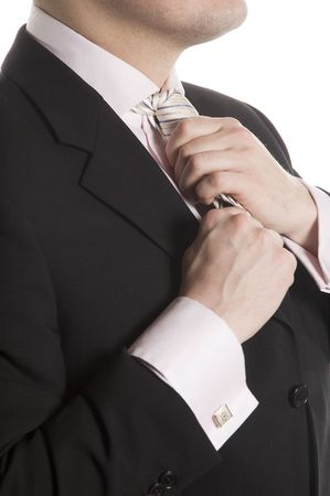 The man in a business suit corrects a tie Stock Photo - 4301276