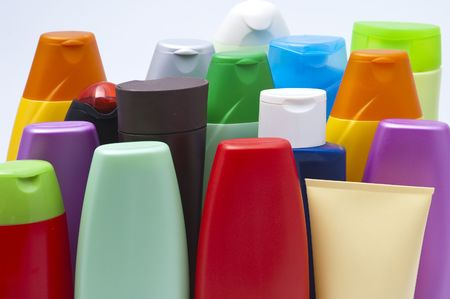 Colour plastic bottles with cosmetic washing-up liquids Stock Photo