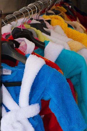dressing gowns: Colour terry dressing gowns in textile shop Stock Photo