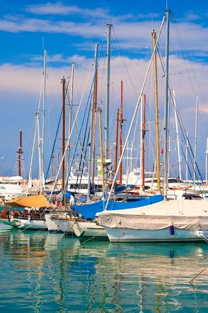 Sea walking sailing yachts in port photo