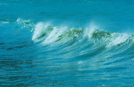 The twirled sea wave approaching on coast