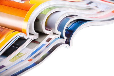 Pile of colour illustrated magazines on white background. Isolated.