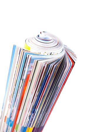 Colour illustrated magazine curtailed into roll on white background. Isolated. photo