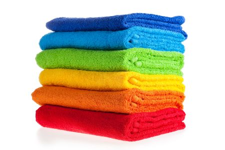 Colour terry towels combined by pile on white background. Isolated.   photo