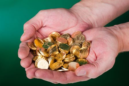 Gold coins lie on hands photo