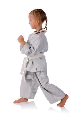 karateka: girl - karateka in kimono on a white background
