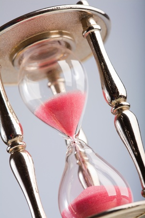Wooden hourglass  on light background photo