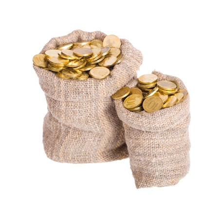 Bags filled with coins. A white background. Isolated.   Stock Photo
