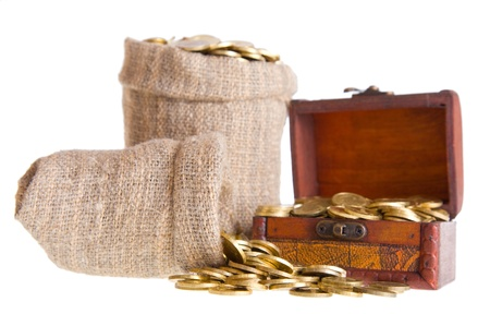 Wooden chest and two bags filled with coins. Isolated on a white background Stock Photo - 8767538
