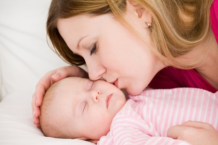 Young mum embraces the falling asleep chest baby photo