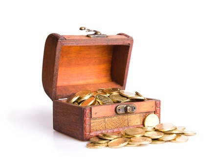 Wooden chest  filled with coins. Isolated on a white background Stock Photo - 8910317