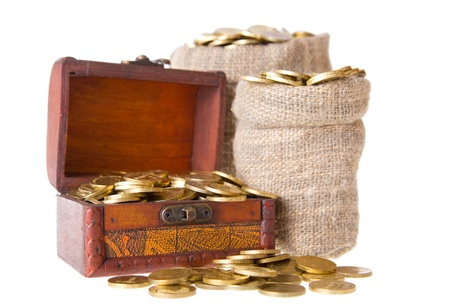 Wooden chest and two bags filled with coins. Isolated on a white background photo