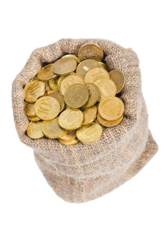 Bag filled with coins. A white background. Isolated.     photo