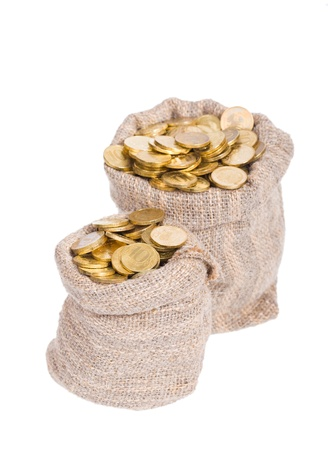 Bags filled with coins. A white background. Isolated.   photo