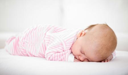 sleeping baby in striped toddlers close up Zdjęcie Seryjne