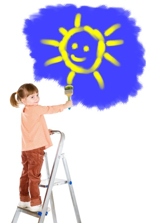 four-year girl on a ladder and draws a picture. It is isolated on a white background photo