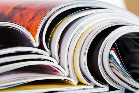 Closeup background of a pile of old magazines with bending pages Stock Photo - 9060372