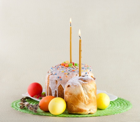 Easter cake with candles on a green background. Easter celebrating. photo