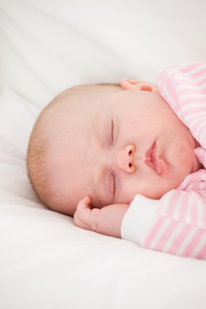 sleeping baby in striped toddlers close up photo