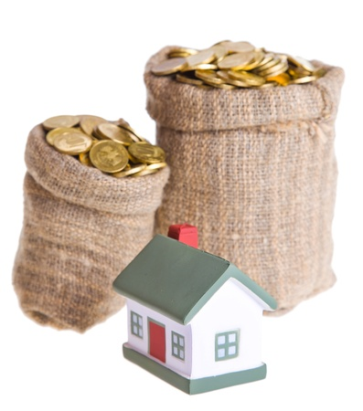 Toy small  house and bags with money. The concept of purchase of habitation Stock Photo - 9139100