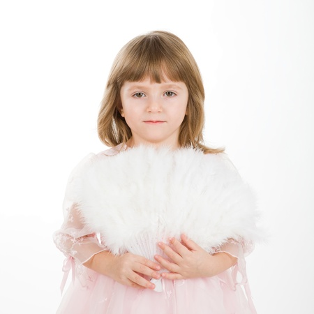 four-year girl in a beautiful pink dress with a fan. It is isolated on a white background Stock Photo - 9139087