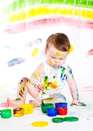 bedaubed: little girl bedaubed with bright colors