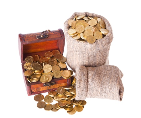 Wooden chest and two bags filled with coins. Isolated on a white background Stock Photo - 9709289