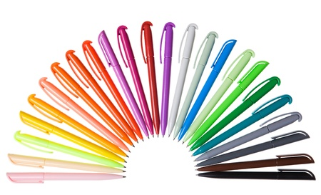 Multi-colored plastic pens. Isolated on a white background Stock Photo