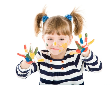 soiled: four-year girl with hands soiled in a paint. It is isolated on a white background