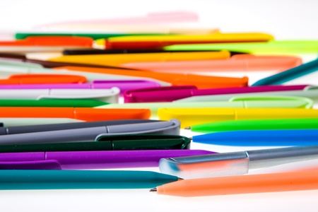 Multi-colored plastic pens. Isolated on a white background photo