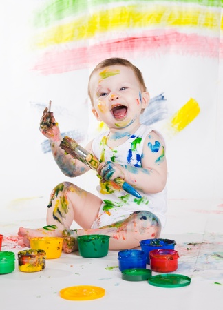little girl bedaubed with bright colors photo