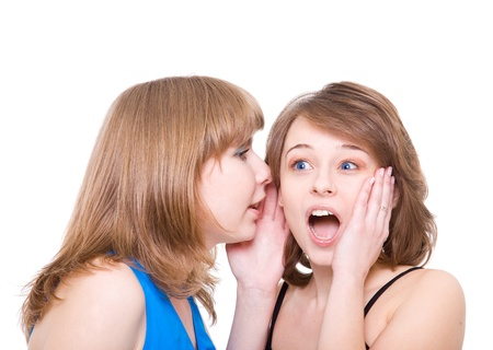 Two girlfriends talk. Close up. White background. It is isolated. Stock Photo - 9958686