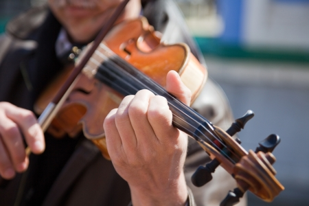 The man plays a violin. Hands of the musician close up. Stock Photo