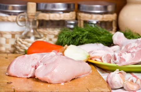 meal preparation: Hen lies on a chopping board. Meal preparation.