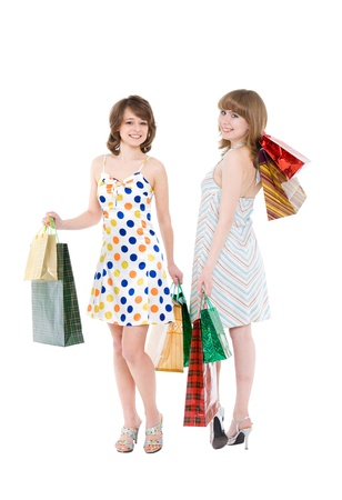 Two happy friends with purchases. It is isolated, a white background. photo