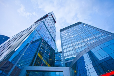 modern office building  in evening, skyscraper in moscow, foreshortening from below