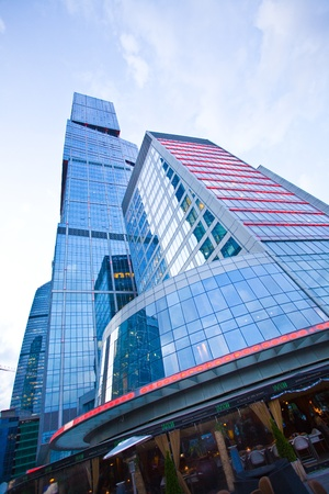 modern office building  in evening, skyscraper in moscow, foreshortening from below photo