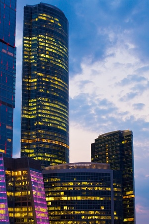 modern office building at night, skyscraper in moscow, foreshortening from below photo