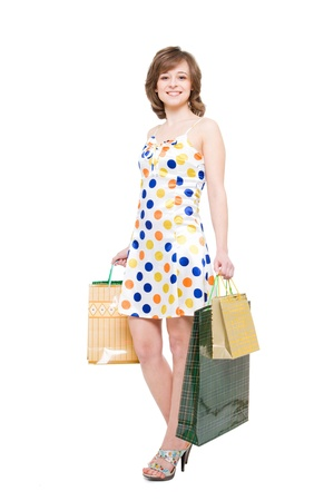 happy girl with purchases. white background, it is isolated photo