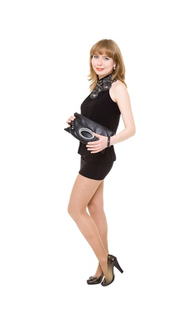 charming girl in a black short dress. Isolated on a white background photo