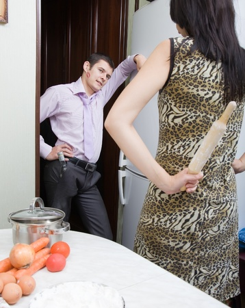 scandal: The drunk husband has come back home with lipstick traces on a cheek. Family scandal. Stock Photo