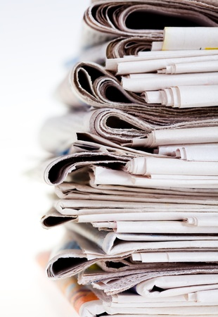 Set of old newspapers combined by a pile