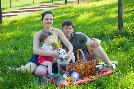 Happy family on country picnic. photo