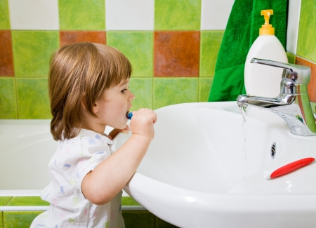 Personal hygiene  Care of an oral cavity  The girl brushes teeth  photo