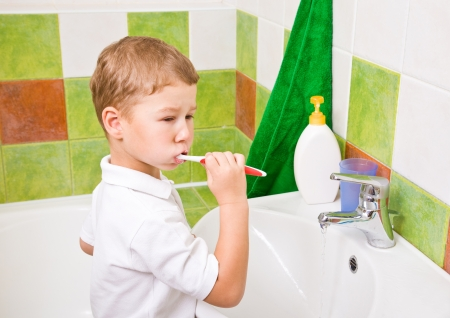 Personal hygiene  Care of an oral cavity  The boy brushes teeth  photo