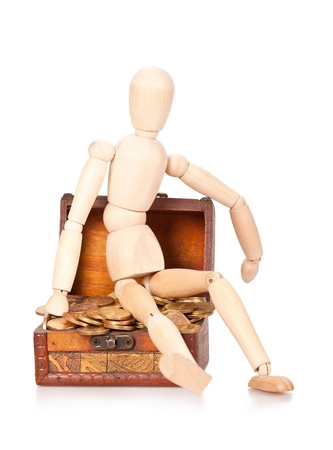 augmentation: Person sits on a chest with money  Preservation and augmentation of riches Stock Photo